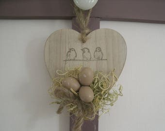 heart wooden decoration spring nest and eggs