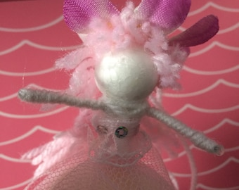 Pink and white flower fairy with sparkles