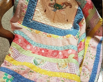 Carousel quilt for baby girl
