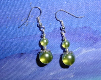 Transparent green glass beads earrings