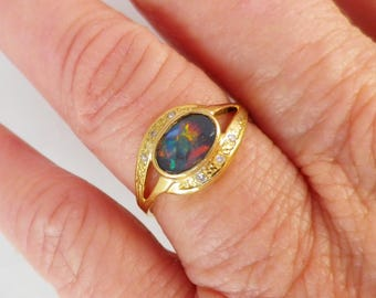 Vibrant vintage black opal & diamond ring in 18 ct yellow gold, excellent condition