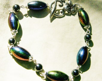 Wonderful Iridescent Bracelet - Glass Rice Bead & Hematite Beads in Silver by JewelryArtistry - BR522