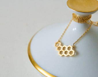 Gilded necklace with honeycomb pendant