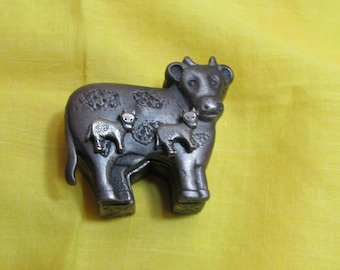 Pewter dairy cow jewlery; set includes cow jewelry container, brooch (top of box), necklace and chain and pierced earrings; 1970's
