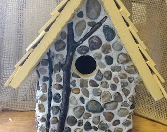 Stone outdoor/indoor birdhouse. Unique made in Michigan. Hanger on top and easy clean out. Fast shipping!