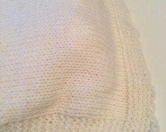 Handmade knitted cream baby blanket