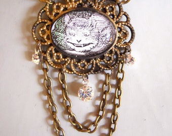 Cheshire Cat Necklace Tea Party Jewelry Alice in Wonderland Character in an Ornate frame Setting with Chains and Crystals