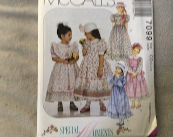 McCalls pattern #7099 child's dress and pinafore size 2,3,4