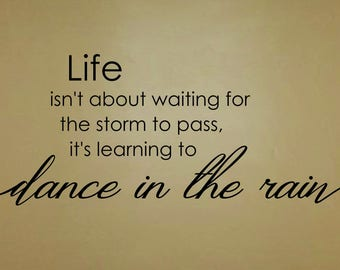 Life isn't about waiting for the storm to pass, it's learning to dance in the rain wall decal / sticker