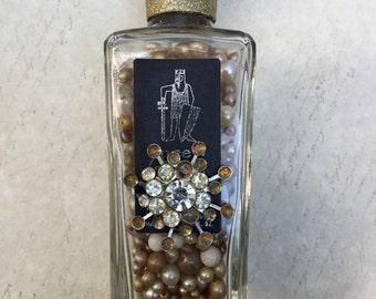 Embellished bottle of faux pearls