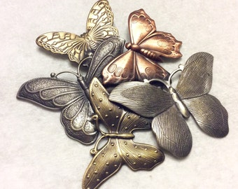 Multi colored metals butterfly cluster repousse brooch pin.