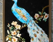 vintage reverse painting on glass. peacock sitting on a branch with flowers. black background