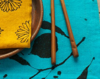 turquoise placemat 100% linen, hand dyed and printed with linden leaves in dark gray