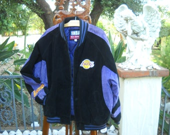 Black & Purple Suede Lakers Fan Jacket in size Large by Carl Banks, 11 x 7 inch embroidered logo on back, padded quilted lining huge pockets