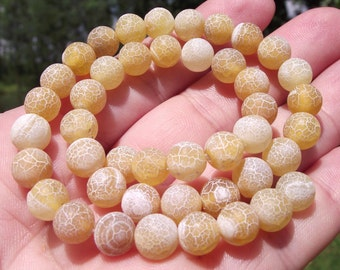 Round 8MM Dragon fire Agate beads.