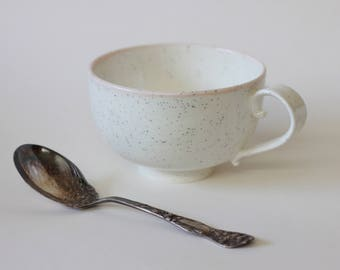Small ceramic cup by Goye. Hand made in Montreal. White and Pink.