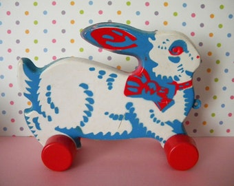 Vintage Tip Top Plastic Easter Bunny Rabbit Toy on Wheels Red White and Blue