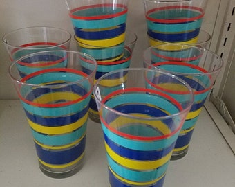 Set of 8 vintage glass tumblers with bright colored stripes