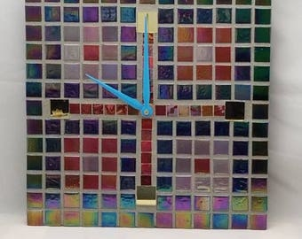 Incredibly colorful iridescent tile mosaic wall clock with 4 yellow mirror tiles for hour markers with teal hands