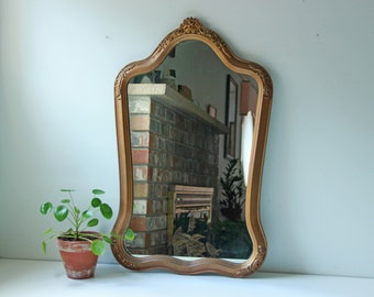Antique Victorian gilt wall mirror with carved floral design
