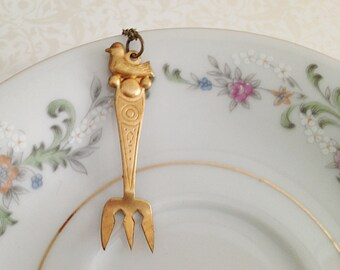 take a bite of life necklace. Miniature Fork. Food Enthusiast. Teeny Gold Fork. Utensil. Bird. Whimsical. Oddities. Brass. Vintage Style.