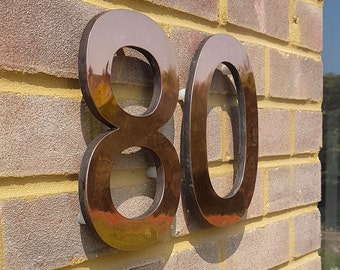 """Large  architectural copper 3D numbers 12""""/305mm high floating with secret fixing, Antigoni font"""