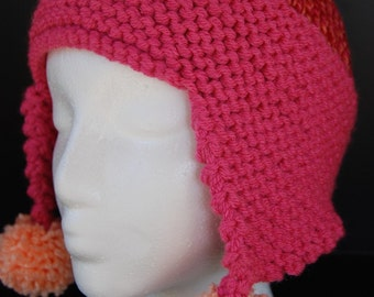 Fun hat with pompoms on earflaps