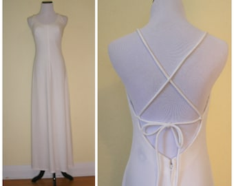 70s white maxi gown by Jack Hartley. Summer disco wedding gown, built in bra-open back-strappy spaghetti ties, full flow skirt, size S-M.