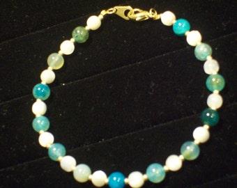 Blue Green White Gold  Beaded Bracelet by hipknitta