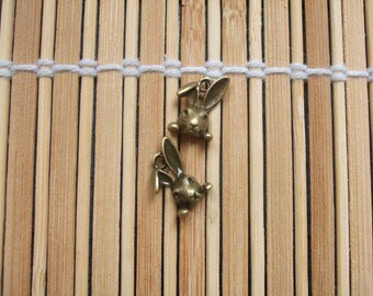 2 brass rabbit charms