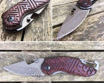 Folding knife with sacred geometric pattern engraving
