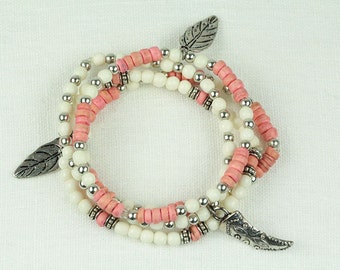 Layered boho bracelet with coral and white beads and feather charms