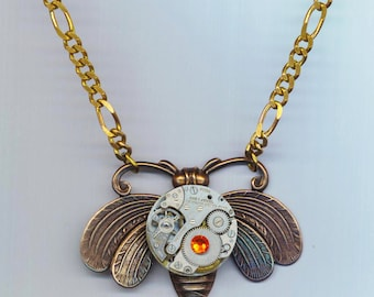 Steampunk Copper Moth Pendant . Vintage Round Watch Movement . Red Swarovski Rhinestone . Birthstone  - Royal by enchantedbeas on Etsy