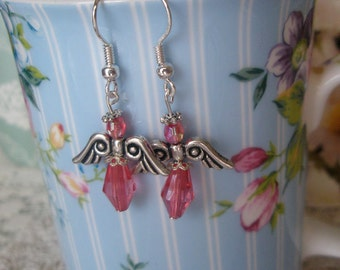 Angel earrings,  coral pink on silver wires