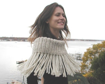 Fringed Shruggle. This versatile knit can be a wrap, shrug, shawl, scarf, infinity scarf, or cowl.   PDF knitting pattern