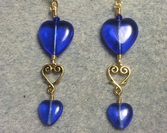 Large and small matching bright blue Czech glass heart bead dangle earrings joined by a gold Tierracast heart connector charm.