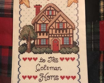 """Welcome to The """"Family Name"""" Home finished and framed  counted cross stitch"""