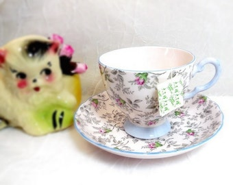 Tuscan Chintz Cup & Saucer Pink Roses, Gray Leaves, Blue Trim