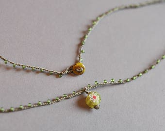 Tiny millefiori charm on daintiest crocheted beaded necklace in greens