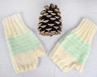 Knitted fingerless mitts, cream with mint green stripe detail.