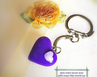 Translucent plum heart with her Lil pink quartz heart on keychain