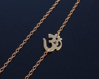 Sideways Om Necklace in 18kt Set Off Center