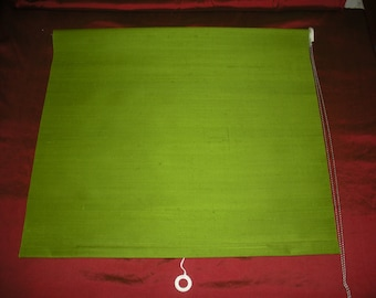 Custom handcrafted lime green Silk Roller Shades on soft room darkening shade cloth