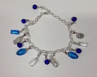 Charm bracelets: Silver bracelets with glass charms.