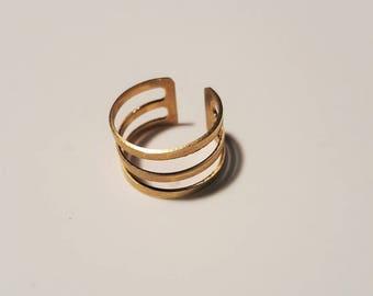 The No. 3 raw gold brass cuff ring holder