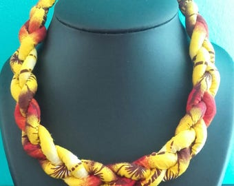 Beautiful necklace is braided fabric loincloth (wax)