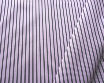 "a beautiful cut of cotton fabric ""black stripes on purple"""