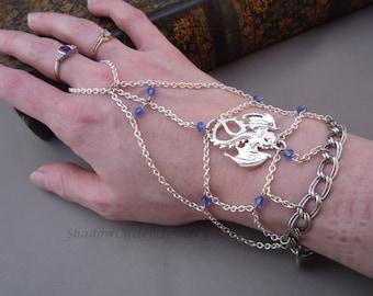 Dragon handflower chain slave bracelet, bright silver tone, sapphire blue Swarovski crystal, adjustable toggle clasp, fantasy ring bracelet