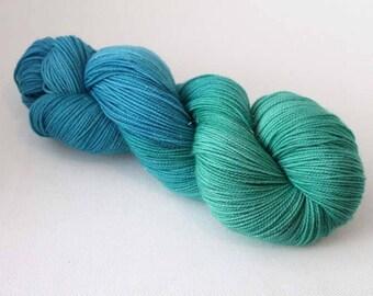 Seaglass, Hand dyed Glitter Sock yarn, 75/20/5 sw merino / nylon / silver stellina