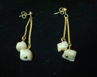 Beautiful gold tone pierced earrings with drop chains and opalescent stones